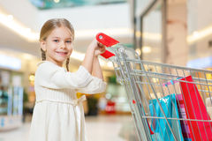 Little cute girl is responsible for shopping. Stock Photos