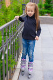 Little cute girl on roller skates in front of her Royalty Free Stock Photos