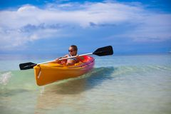Little cute girl rowing a boat in clear sea Royalty Free Stock Photos