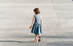 Childhood concept. Cute preschool girl is running stock photography