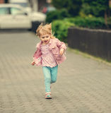 Little cute girl running Royalty Free Stock Images