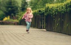 Little cute girl running Stock Photos