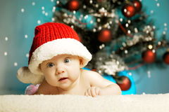 Little cute girl with santa hat Royalty Free Stock Image