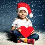 Little cute girl with santa hat Stock Images