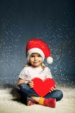 Little cute girl with santa hat Royalty Free Stock Photos