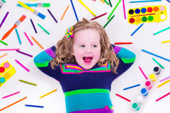 Little cute girl with school art supplies Royalty Free Stock Photography