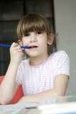 Little cute girl seven years old do homework. Stock Photos