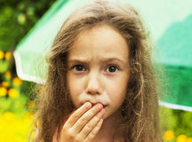 Little cute girl is shocked and surprised Stock Images