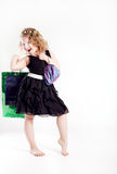 Little cute girl shopping. Stock Images