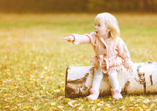 Little cute girl shows gesture hands toward Stock Photos