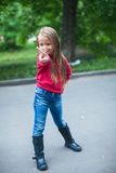 Little cute girl shows the thumb outdoor Stock Photo