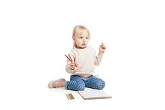 Little cute girl sitting on floor and drawing with Stock Photography
