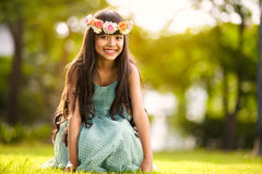 Little cute girl sitting in park Royalty Free Stock Photo