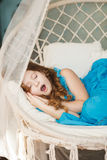 Little cute girl sleeping on swing Stock Image