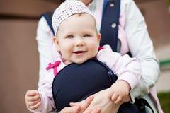 Little cute girl in sling. Stock Image