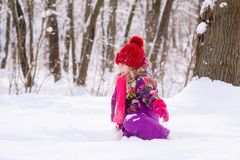 Little cute girl in snow royalty free stock images