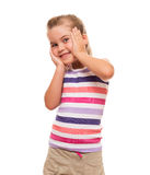 Little cute girl standing wonderful against white backdrop Royalty Free Stock Image