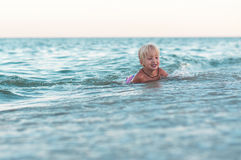 Little cute girl swimming in the sea Royalty Free Stock Photography