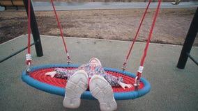 Little cute girl swinging on strong net round swing. stock footage