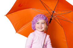 Little cute girl with an umbrella isolated on white background Stock Photo
