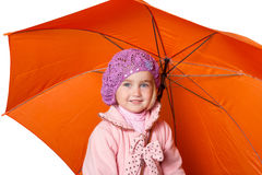 Little cute girl with an umbrella isolated on white background Royalty Free Stock Photos