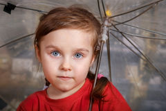 Little cute girl with umbrella Stock Photos
