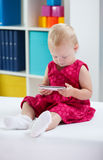 Little cute girl using phone Stock Images