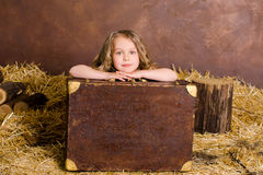 Little cute girl with vintage brown suitcase Stock Images