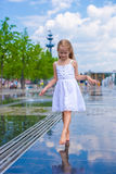 Little cute girl walking in open street fountain Stock Image