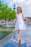 Little cute girl walking in open street fountain Stock Photos