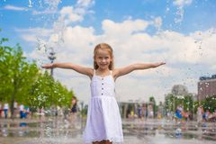 Little cute girl walking in open street fountain Royalty Free Stock Photos