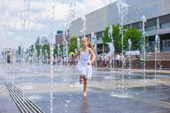 Little cute girl walking in open street fountain Royalty Free Stock Images