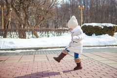 Little cute girl walks in the winter on a sunny Royalty Free Stock Photos