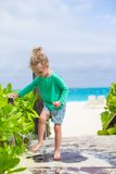 Little cute girl washes out the sand from her feet Stock Photo