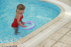 Little cute girl in water pool Royalty Free Stock Photos