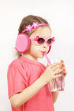 Little cute girl wearing pink clothes is drinking water stock photos
