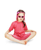 Little cute girl wearing pink clothes sitting over white Royalty Free Stock Photography