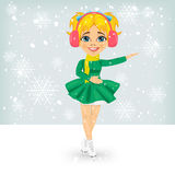 Little cute girl in winter coat skating outdoors on the ice rink Stock Photo