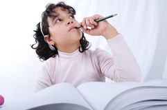 A little cute girl writting on notebook Stock Photo