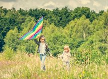 Little cute girls flying a kite Stock Images