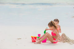 Little cute girls playing with beach toys during tropical vacation Royalty Free Stock Photos