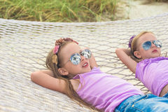 Little cute girls relaxing in hammock on summer Stock Images