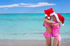 Little cute girls in Santa hats having fun on Stock Photo