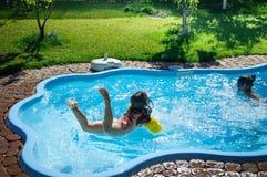 Little fun girl is swimming pool royalty free stock image