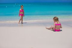 Little cute girls walking along the white beach Royalty Free Stock Images