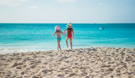 Little cute girls walking on white beach during Stock Image