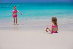 Little cute girls walking on white beach during Royalty Free Stock Photos