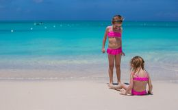 Little cute girls walking on white beach during Royalty Free Stock Image
