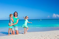 Little cute girls and young mother during tropical Royalty Free Stock Images