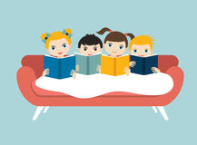 Little cute group of three children reading a books sitting on the sofa. Stock Photography